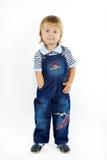 Le petit garçon dans des combinaisons Photos stock