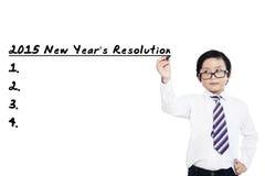 Le petit garçon fait des résolutions en 2015 Image libre de droits