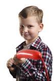 Le petit garçon gonfle le ballon, Photos libres de droits
