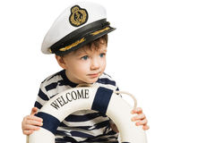 Le petit marin garde la bouée de sauvetage Image stock