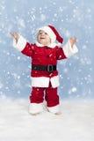 Le petit père noël dans la neige Photos stock