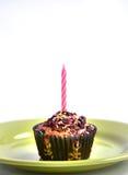 Le petit pain de couleur pour des enfants font la fête avec la bougie au dessus Photo stock