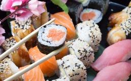 Le petit pain de sushi a fait le plat Image stock