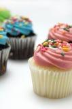 Le petit pain rose avec coloré arrose Photographie stock libre de droits