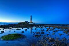 Le phare de St Mary au coucher du soleil Photographie stock libre de droits
