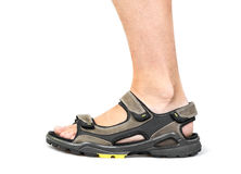 Le pied des hommes en sandales Photo stock