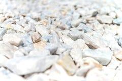 Le pietre bianche hanno offuscato il fondo Immagine Stock