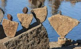 Le pietre gradicono la gente fotografia stock