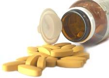 Le pillole hanno versato dal barattolo su fondo bianco Fotografia Stock