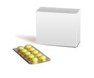 Le pillole rotonde gialle e l'casella-imballaggio grigio sono isolat immagini stock libere da diritti