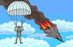 Le pilote descend par le parachute Images stock