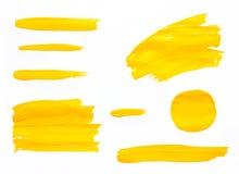 Le pinceau frotte l'aquarelle jaune de texture Photo stock