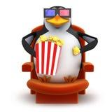 le pingouin 3d mange du maïs éclaté tout en observant un film 3d Photos libres de droits