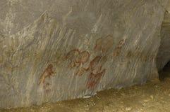 Le pitture reali della roccia dell'uomo antico Fotografia Stock