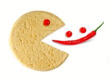Le pizza-sourire conceptuel mangent du poivre Photographie stock