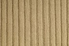 Le plan rapproché d'un fragment de tricotent avec une armure caractéristique de fil tricots photographie stock libre de droits