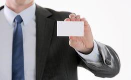 Le plan rapproché de la carte de visite professionnelle de visite équipe dedans la main Endroit pour votre texte Photographie stock libre de droits