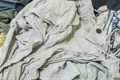 Le plan rapproché a employé le fond de vêtements image stock