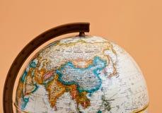 Le plan rapproché de globe avec la Chine et l'Asie Photo libre de droits