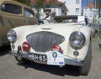 Le plan rapproché 1955 de plein-visage du ` s d'Austin-Healey-100 Le Man de voiture Image libre de droits