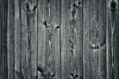Le plance di legno misere del grano nero naturale strutturano come fondo Fotografie Stock