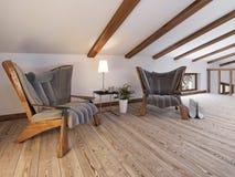 Le plancher de grenier avec des places assises avec des chaises de concepteur et un l Photographie stock libre de droits
