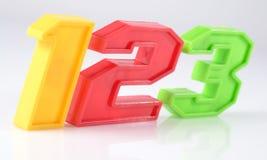 Le plastique coloré numéro 123 sur le blanc Photos libres de droits