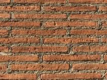 Le plein cadre du mur de brique et de ciment dans le jour s'allument Images stock