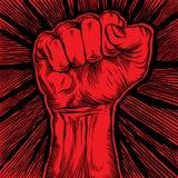 Le poing serré a tenu la haute dans la protestation Image libre de droits