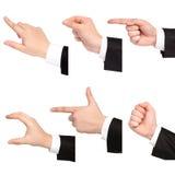 le point ou la prise de main d'homme d'affaires ou touchent tous les objets Photos stock