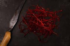 Le poivre de piments rouges chaud supplémentaire filète des ficelles Images libres de droits