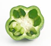 Le poivron doux vert a coupé moitié-moitié Photos libres de droits