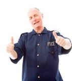 Le policier montrant des pouces lèvent le geste Photographie stock libre de droits