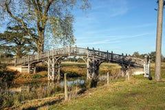 Le pont chinois de ` de `, parc de Croome Images stock