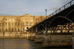 Le Pont des Arts. PARIS, FRANCE, January 26, 2016 : A pedestrian bridge (Le Pont des Arts) links the Institut de France and the central square of the Palais du Royalty Free Stock Photos
