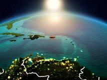 Le Porto Rico dans le lever de soleil de l'orbite Photographie stock libre de droits