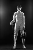 Le portrait du costume de clôture blanc de port de femme sur le noir Photographie stock libre de droits