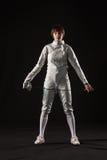 Le portrait du costume de clôture blanc de port de femme sur le noir Images libres de droits