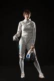 Le portrait du costume de clôture blanc de port de femme sur le noir Photos libres de droits