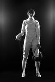 Le portrait du costume de clôture blanc de port de femme sur le noir Photographie stock