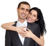 Le portrait romantique de couples, visages heureux, habillés dans le costume noir, a isolé le blanc Photographie stock libre de droits
