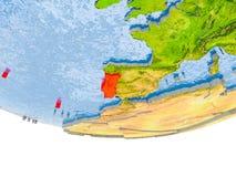 Le Portugal en rouge sur le modèle de la terre Photos libres de droits