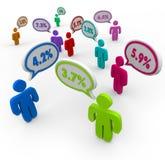 Le pour cent numérote comparer parlant de personnes de taux d'intérêt mieux  Photos stock