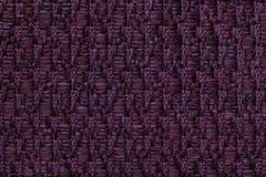 Le pourpre foncé a tricoté le fond de laine avec un modèle de tissu mou et laineux Texture de plan rapproché de textile Photo stock