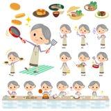 Le pourpre vêtx la cuisson de grand-mère illustration stock
