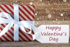 Le présent avec des flocons de neige, textotent le jour de valentines heureux Image stock