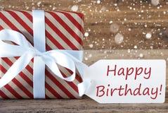 Le présent avec des flocons de neige, textotent le joyeux anniversaire Photographie stock