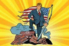 Le Président Donald Trump avec le drapeau des Etats-Unis, sur les ruines Photos libres de droits