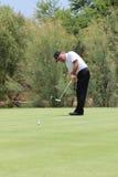 Le pro golfeur Thomas Levet des hommes allant chercher le long mis en novembre Image libre de droits