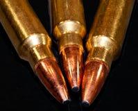 Le punte di tre pallottole del fucile Fotografia Stock